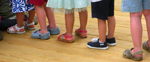 line of kids feet